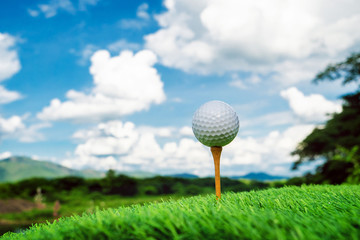 Close up golf ball with nature background.