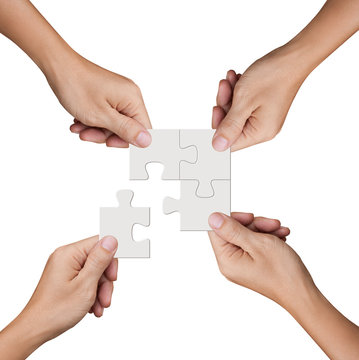 Hand holding jigsaw puzzles, Business partnership and teamwork concept