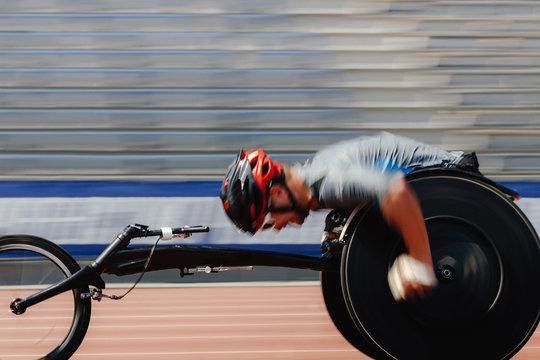 athlete racer on wheelchair racing track stadium