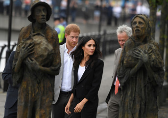 Britain's Prince Harry and Meghan, the Duchess of Sussex, visit the Famine Memorial in Dublin
