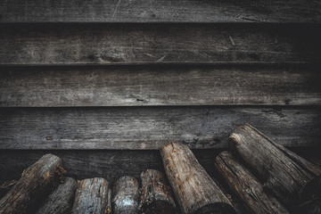 pile of firewood and wooden plank wall