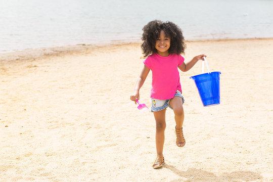 Portrait of smiling girl having fun on beach