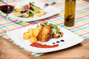 Breaded chicken fillet with fresh vegetables