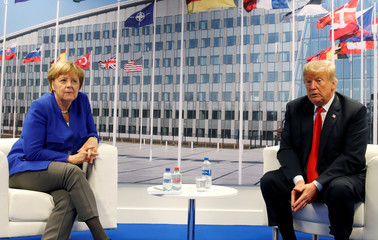 Trump meets with Merkel at the NATO summit in Brussels