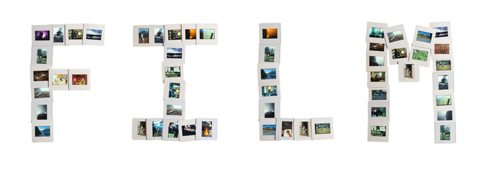 Film word written using photo slides with clipping path. Old film slides arranged to convey the concept of visual creation