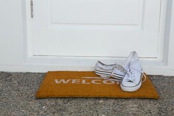 Canvas shoes on a door mat