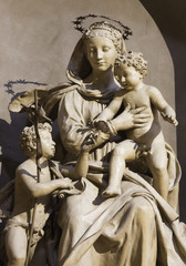 PARMA, ITALY - APRIL 15, 2018: The carved statue of Madonna with the Child and St. John the Baptist in church Chiesa di San Giovanni Evangelista by  Antonio Begarelli (1543).