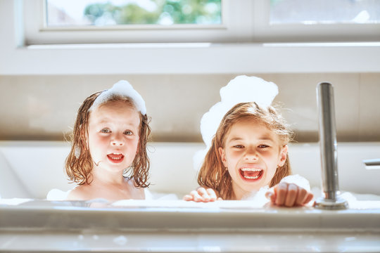 children are bathing in a bath