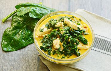 Spinach and chicken breast  with curry and coconut soup Thai menu. ( Thai name is Gaeng Om kai  pak khom)