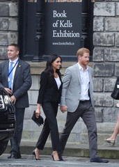 Britain's Prince Harry and Meghan, the Duchess of Sussex arrive at the Book of Kells Exhibition at Trinity College during their visit to Dublin