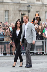 Britain's Prince Harry and Meghan, the Duchess of Sussex walkabout during a visit to Trinity College in Dublin