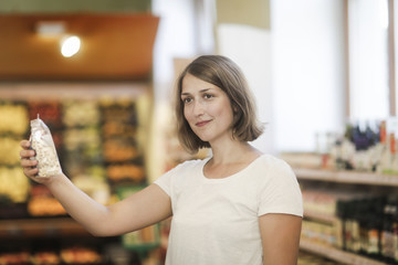 Woman shopping for food in a store
