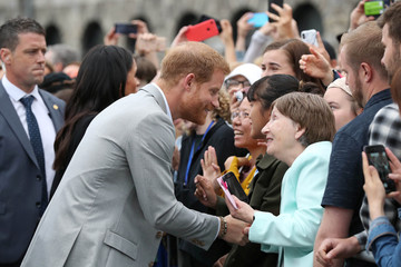 Britain's Prince Harry meets local people during a visit to Trinity College in Dublin
