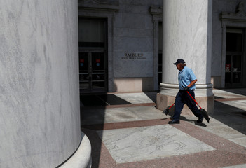 A man sweeps outside of the Rayburn House office building in Washington