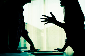 Silhouette Asian couple is fighting by the windows