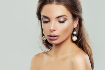 Woman with perfect makeup and pearls earrings, beauty portrait