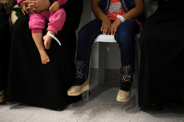 Syrians sit in a hospital after they crossed the armistice line from Syria to the Israeli-occupied Golan Heights to get medical treatment in Israel