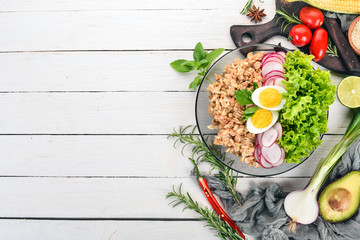 Healthy food. Oatmeal, lettuce, radish, egg. On a wooden background. Top view. Free copy space.