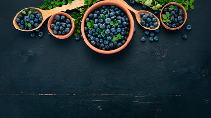Fresh berries of blueberries. On a wooden background. Top view. Free space for your text.