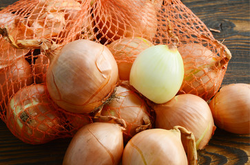 The brown onion or yellow onion is a variety of dry onion with a strong flavour. onion in the net.