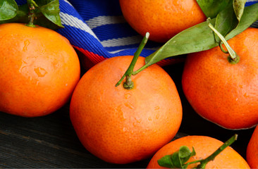 Nutritional Value of a Clementine. A lot of Clementines,orange or citrus with blue clothon wooden background.