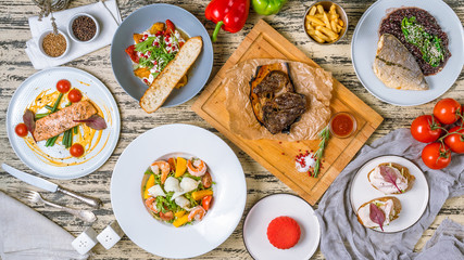 Assorted European dishes salmon, Dorado, meat, salads