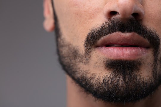 Close up on the mouth and chin of a bearded man