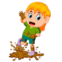 Little girl playing in the mud
