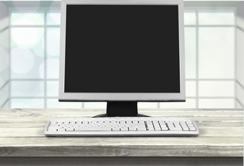 Desktop computer and keyboard on desk