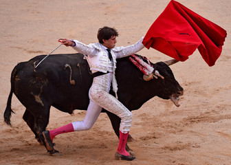 Peruvian bullfighter Andres Roca Rey performs a pass during a bullfight on the sixth day of the San Fermin festival in Pamplona