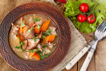Lamb stew with carrots, onion, parsley