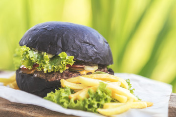Burger made with black charcoal bun served