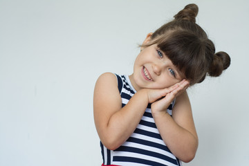Photo of pleased dreamy little girl wonk with trendy hairdo. Copy space