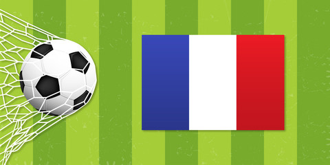 A realistic ball hits the gate on a green background with france flag