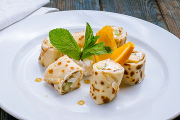 sweet roll with fruit and cheese