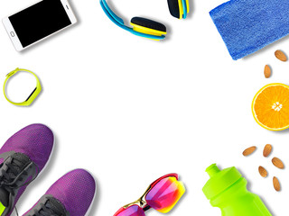 Top view of sport accessories and footwear for fitness and training with copy-space. Running shoes, smartphone, bottle etc. isolated on white background. Healthy lifestyle concept
