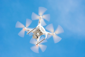 Drone Of White Color Flying In The Blue Sky, Concept Video Technology.