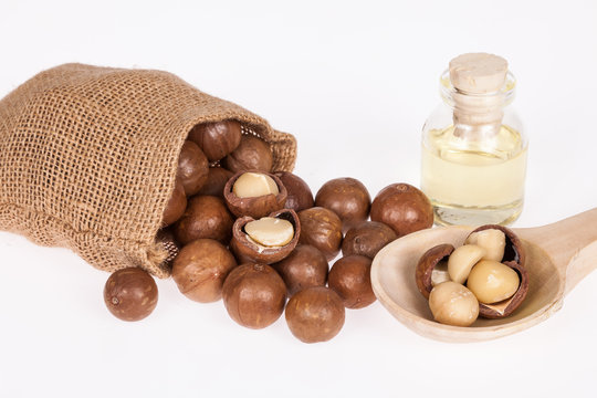 Macadamia nuts oil or Australian walnuts on white background