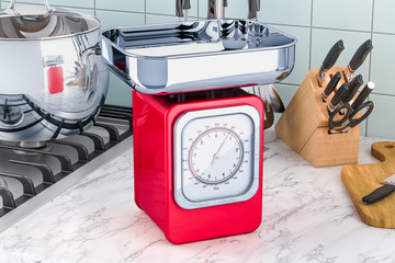 Red Kitchen Scale on the kitchen table. 3D rendering