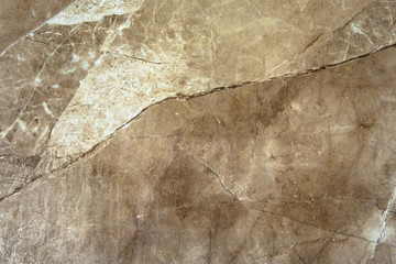 The texture of the marble is a green-brown shade.