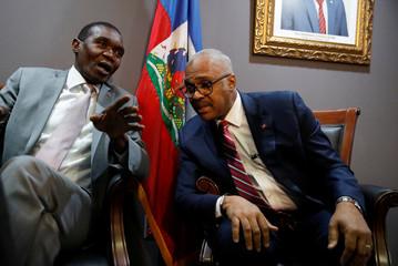Haitian Senate President, Joseph Lambert, and Prime minister Jack Guy Lafontant speak before a news conference in Port-au-Prince