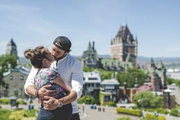 Pregnant couple portrait outside in Quebec city