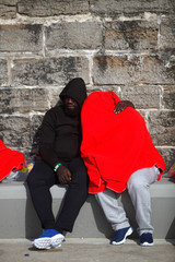 A migrant couple rests after arriving on a rescue boat at the port of Tarifa