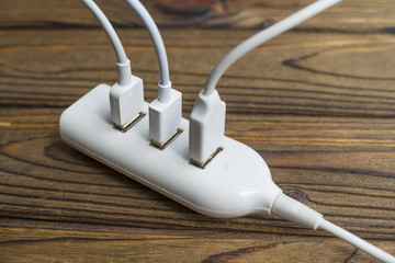 three wires are connected to the USB port of the hub. The concept of data exchange, charging, connection, connectors.