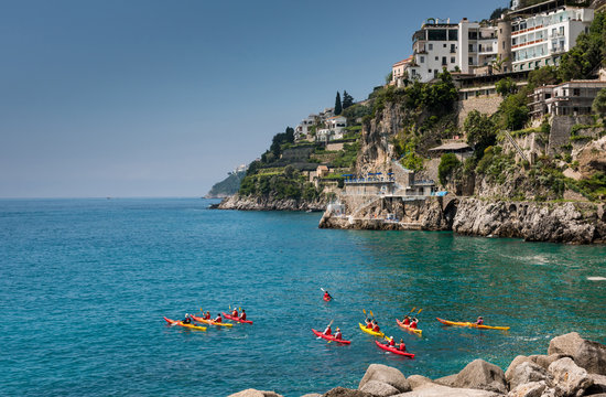 A group of people cayaking on the sea