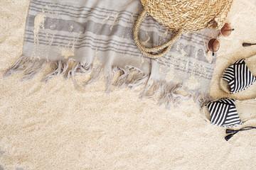 Beach towel on sandy floor