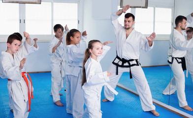 Smiling children training to master new moves