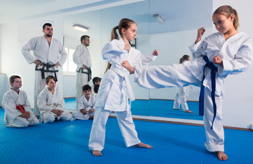 Young children are trying in sparring to use new moves