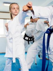 Children training in pairs