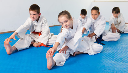 Children stretching before karate class